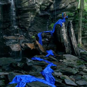 Conceptual composite at a waterfall – 'THE FALL'